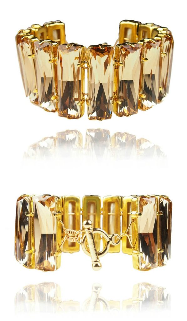 The JY Jewels Lyra bracelet in bright ochre crystal and gold.