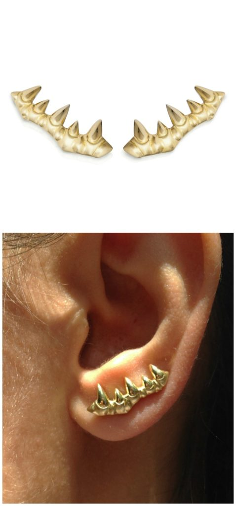 The tooth ear climber fromLisa Kim's newest jewelry collection, The Seabeast. In gold with a textured matte finish.