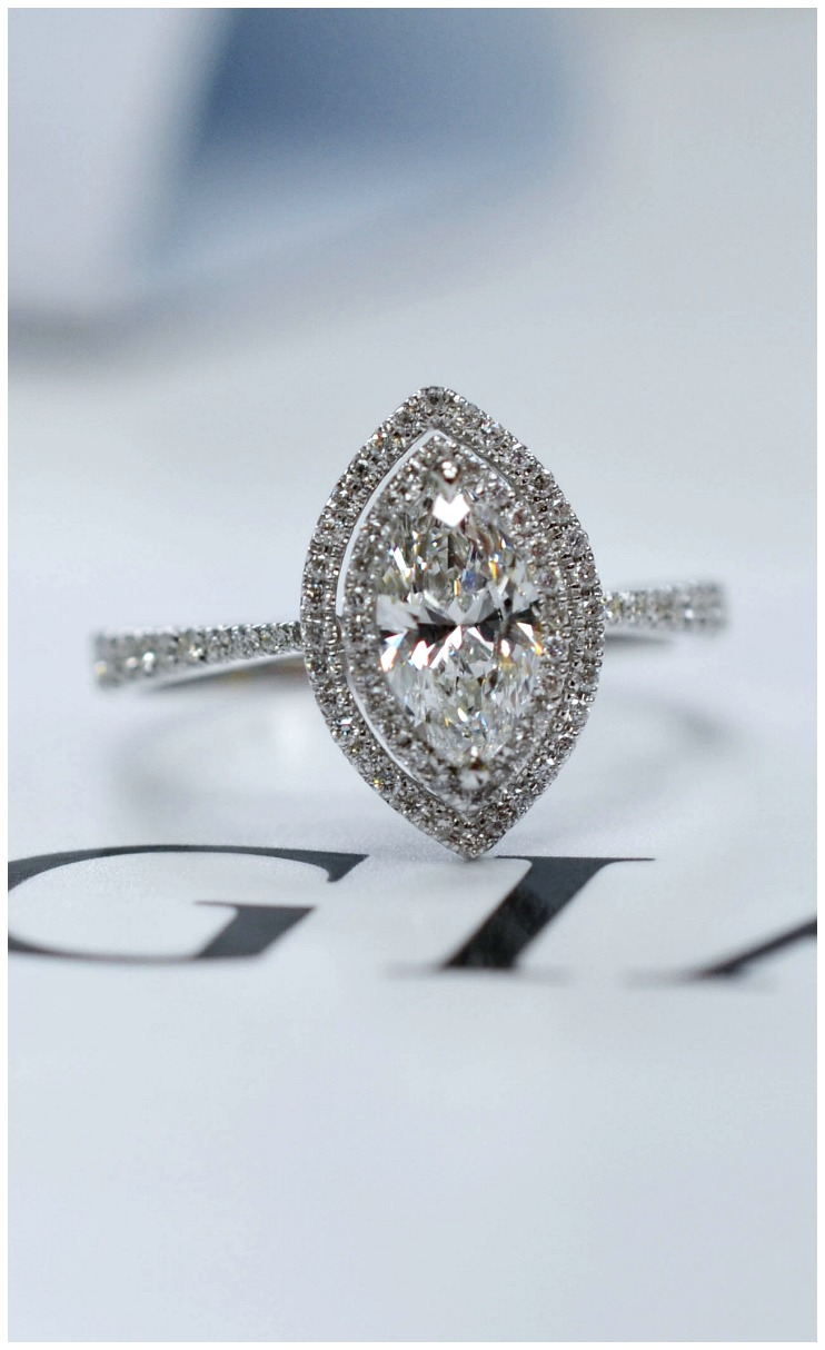 A custom engagement ring by I.D. Jewelry featuring a beautiful marquise cut diamond.