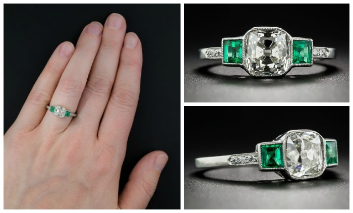A beautiful antique engagement ring with a cushion-cut diamond sandwiched between two lovely emeralds. Art Deco, circa 1915-1920. At Lang Antiques.