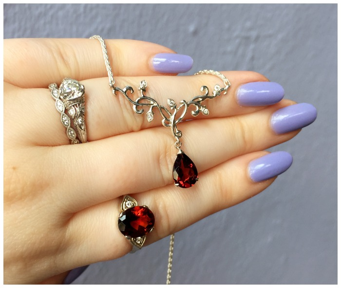 A beautiful garnet ring with a matching necklace, both made by Hunt Country Jewelers.