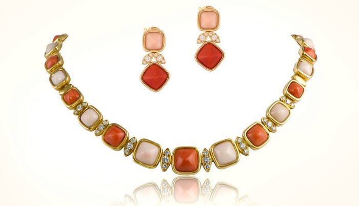 A necklace and earring set of coral jewelry by Van Cleef and Arpels, circa 1960's. Set in gold, with diamonds. At M. Khordipour.