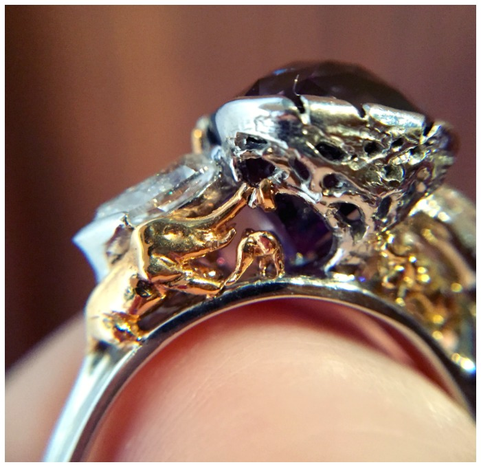 This incredible tanzanite ring by Hunt Country Jewelers features an intricate setting with tiny, golden animals. Look at those elephants!