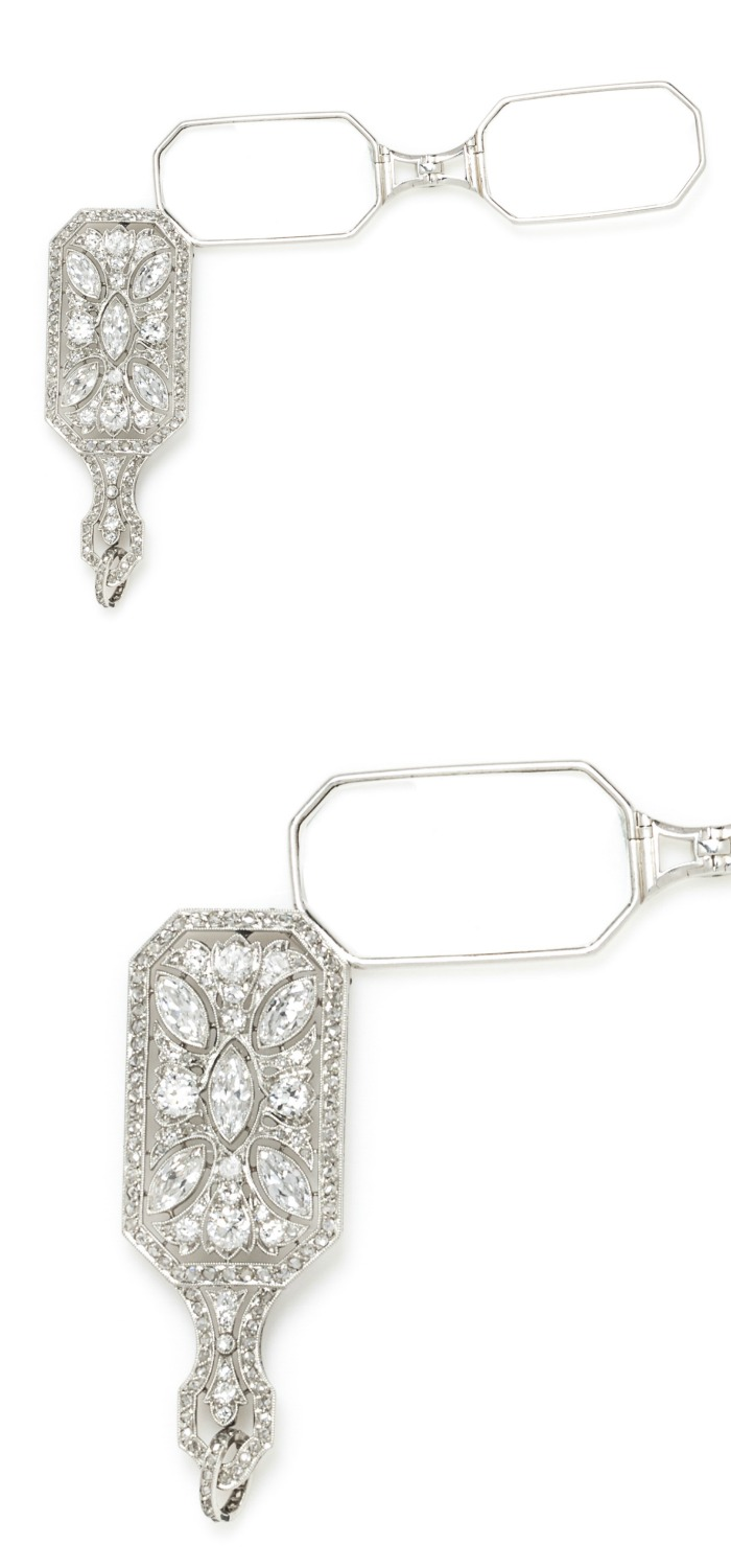 A Fine Art Deco Platinum and Diamond Lorgnette, Charlton & Co.. The glasses fold into the diamond element, which can be worn as a pendant.