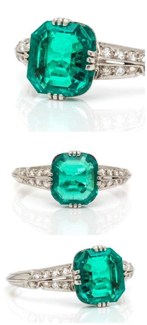 An Art Deco Platinum, Colombian Emerald and Diamond Ring, Tiffany & Co., containing one octagonal step cut emerald with diamonds.