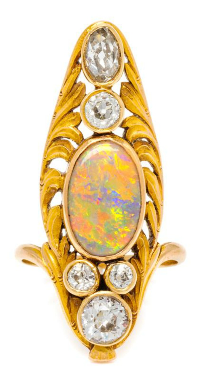 An antique Art Nouveau yellow gold ring with opals and diamonds.