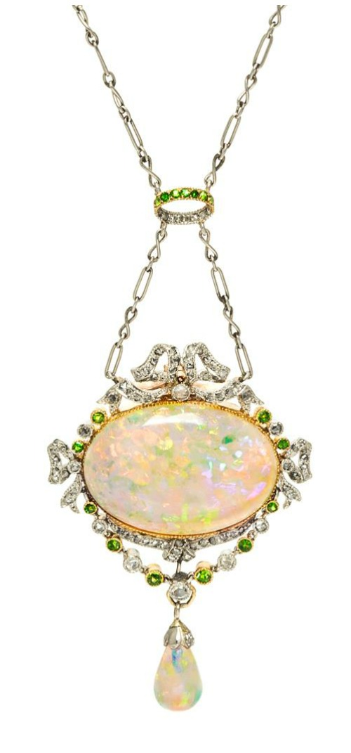 An antique Belle Epoque platinum, rose gold, opal, diamond, and demantoid garnet necklace.