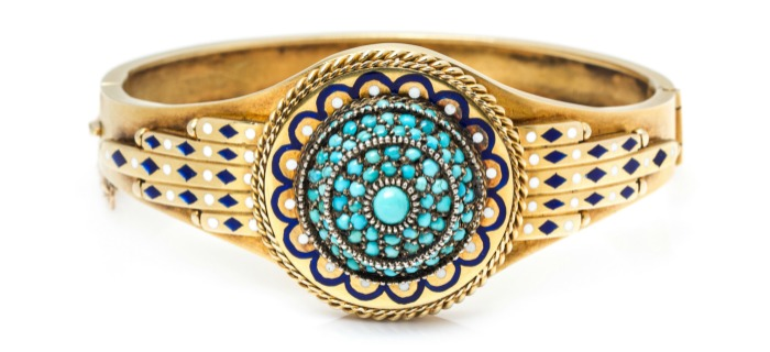 An antique Egyptian revival brangle bracelet with enamel details and turquoise. In Leslie Hindman's upcoming September jewelry sale.
