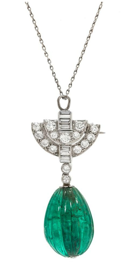 An emerald and diamond pendant brooch by Tiffany & Co.