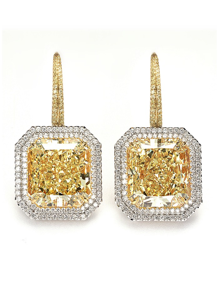 Forevermark Exceptional diamond fancy yellow diamond radiant cut earrings.