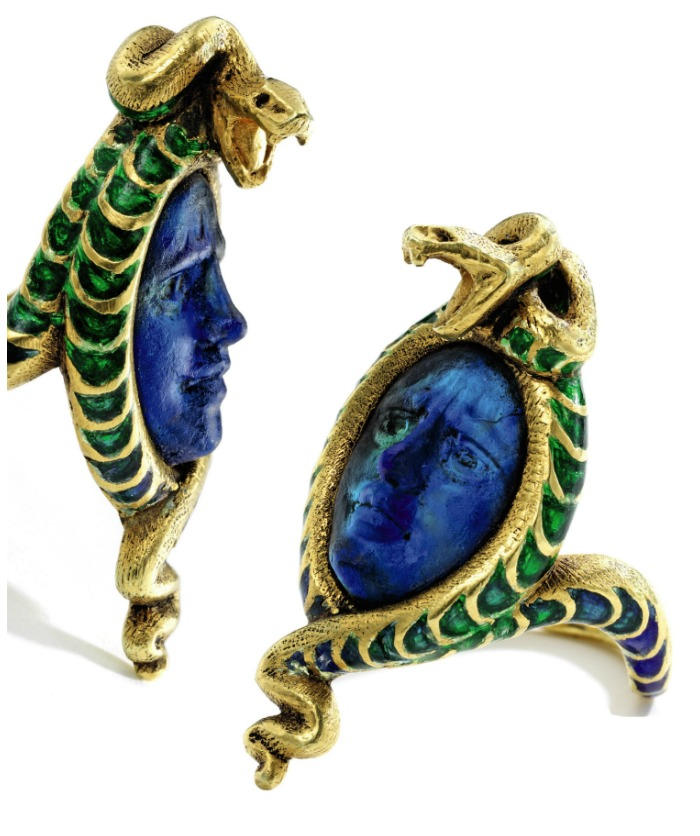 A gold, glass, and enamel Medusa ring by the legendary Art Nouveau jeweler, René Lalique. Circa 1900.