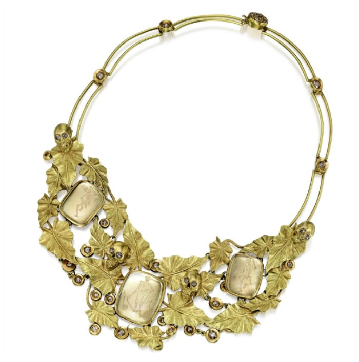 A gold, rock crystal and diamond 'Pierrot' necklace by Codognato. With gold skulls, brown rose cut diamonds, and rock crystal reverse intaglios in gold ivy.