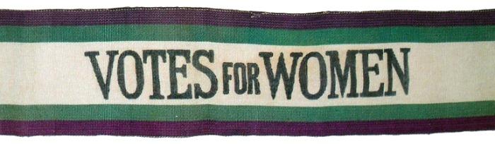 A purple, green, and white suffragette sash.