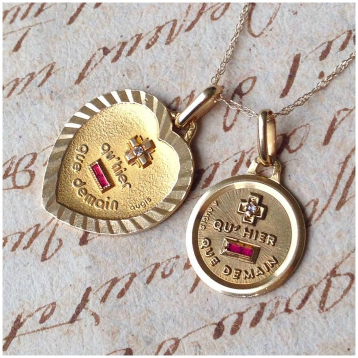 Two vintage French love charms - the  Augis medaille d'amour available from Erin Antiques.