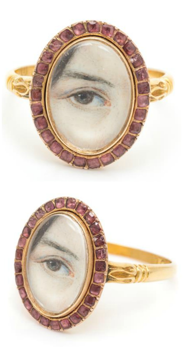 A Georgian Lover's Eye ring in gold with flat cut garnets, from Leslie Hindman Auctioneers December Important Jewelry Sale.