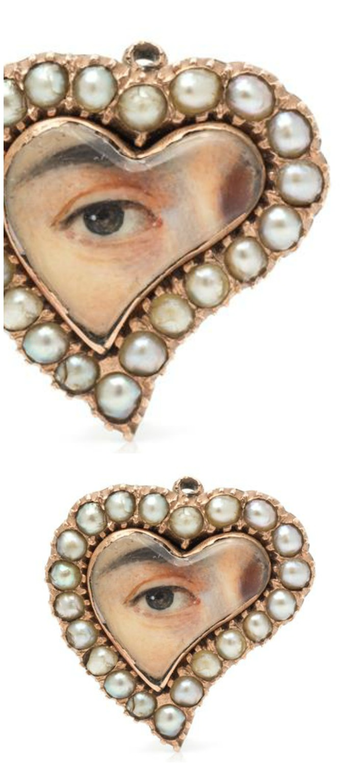A Georgian Rose Gold and Seed Pearl Lover's Eye Brooch in a heart shape design.