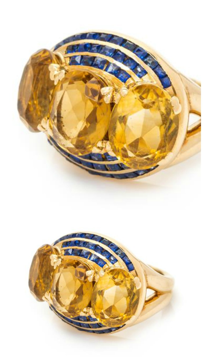 A fantastic and unusual yellow gold, citrine, and sapphire ring.