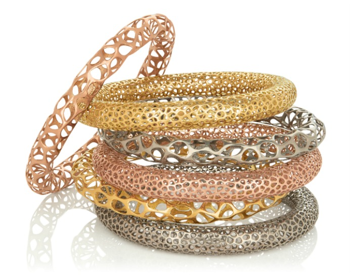 A stack of metal lace bangles from Vitae Ascendere.