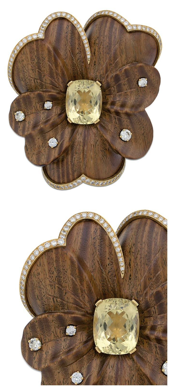 A unique gold, diamond, citrine and wood flower brooch currently up for auction and available through Bidsquare.