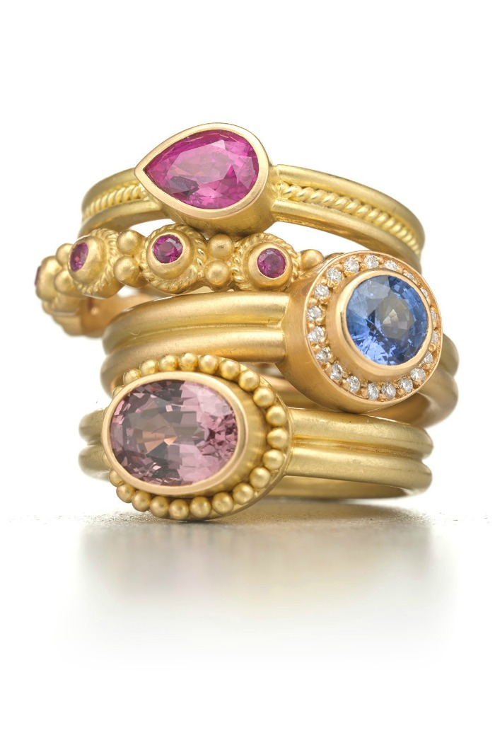 A stack of rings by Reinstein Ross, in gold with diamonds and colored gemstones .
