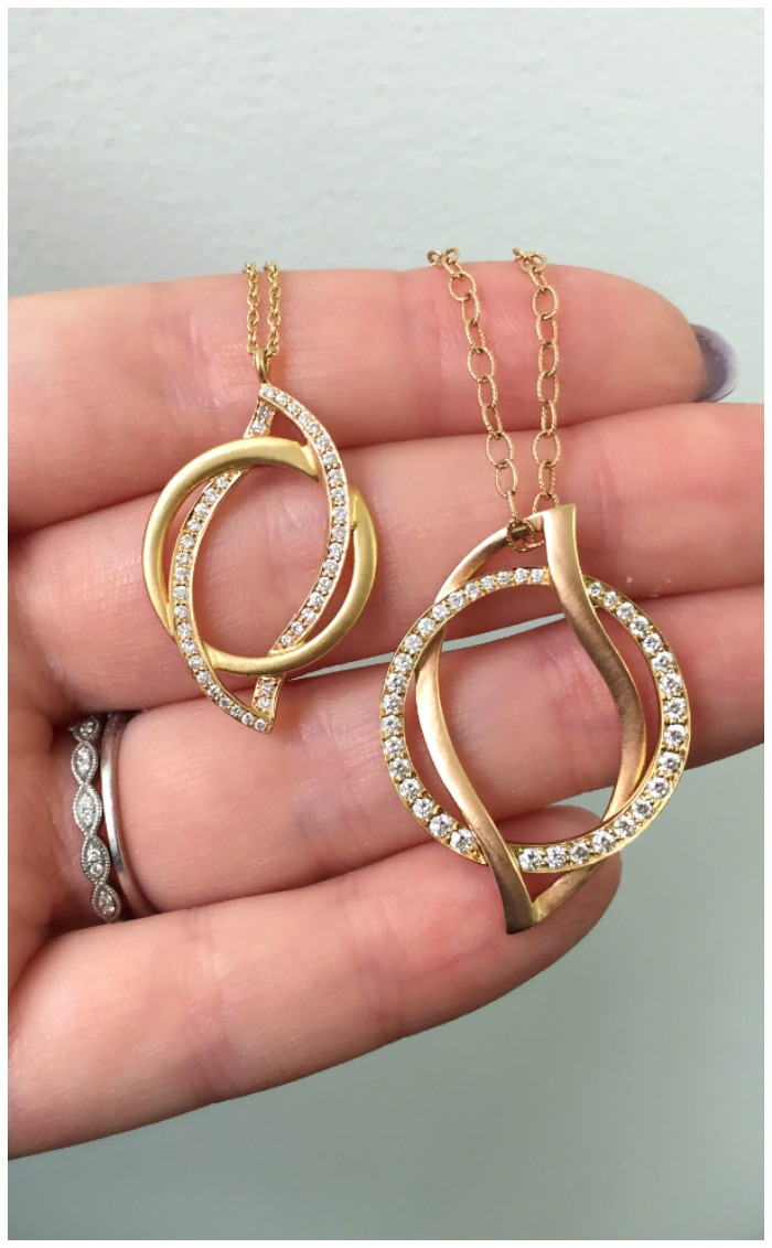Two beautiful gold and diamond pendants by Carelle.
