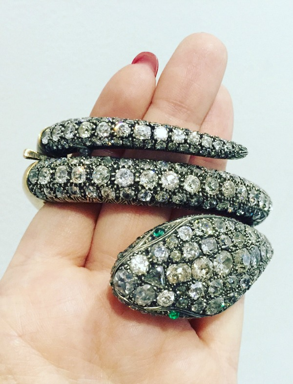 A magnificent antique snake bracelet from Mario's Antiques. Diamonds over gold with emerald eyes.