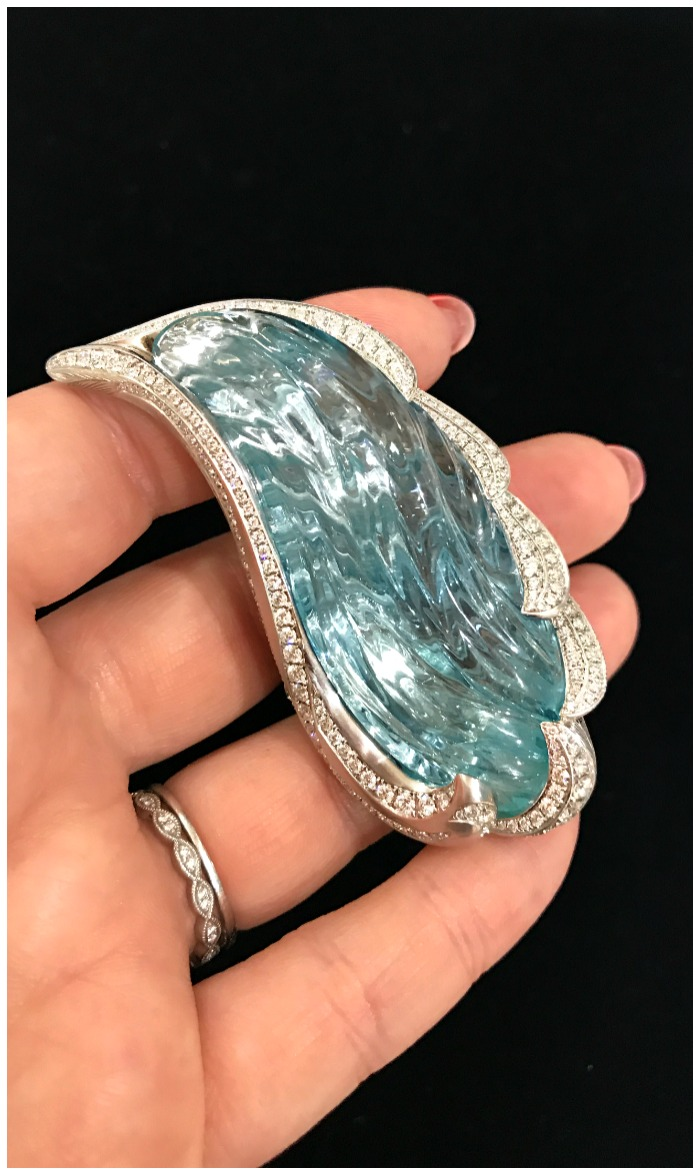 A magnificent carved aquamarine brooch by Naomi Sarna.