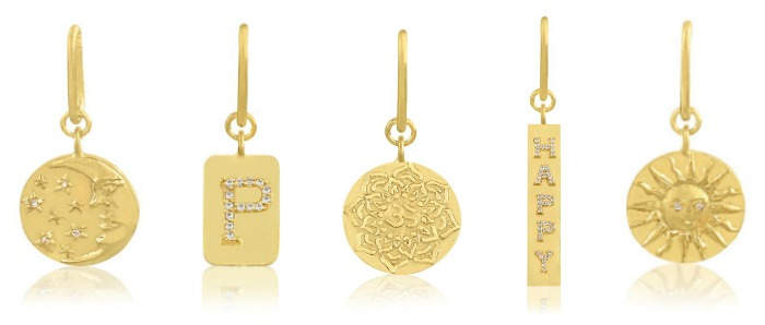 A selection of gold amulets by Stella Flame jewelry.