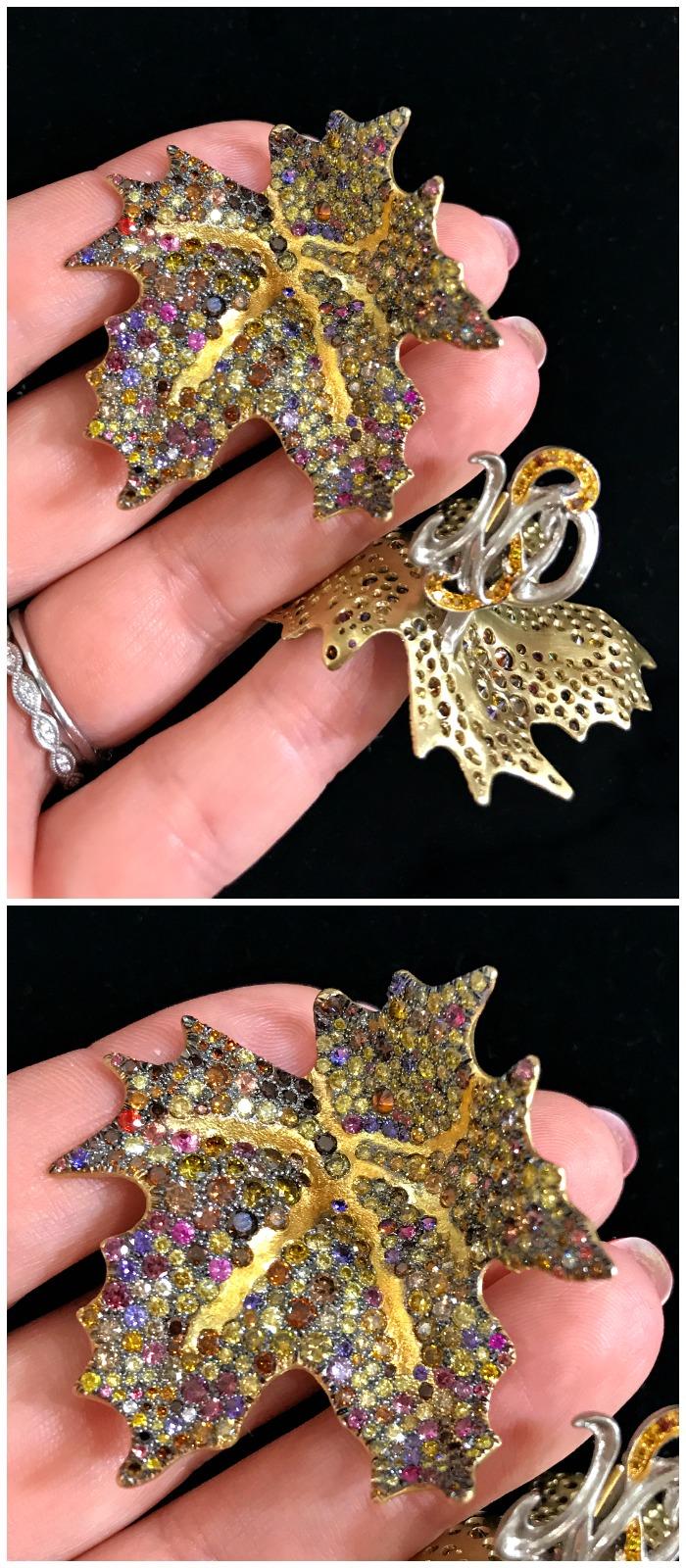 An incredible pair of gem-set maple leaf earrings by Naomi Sarna.