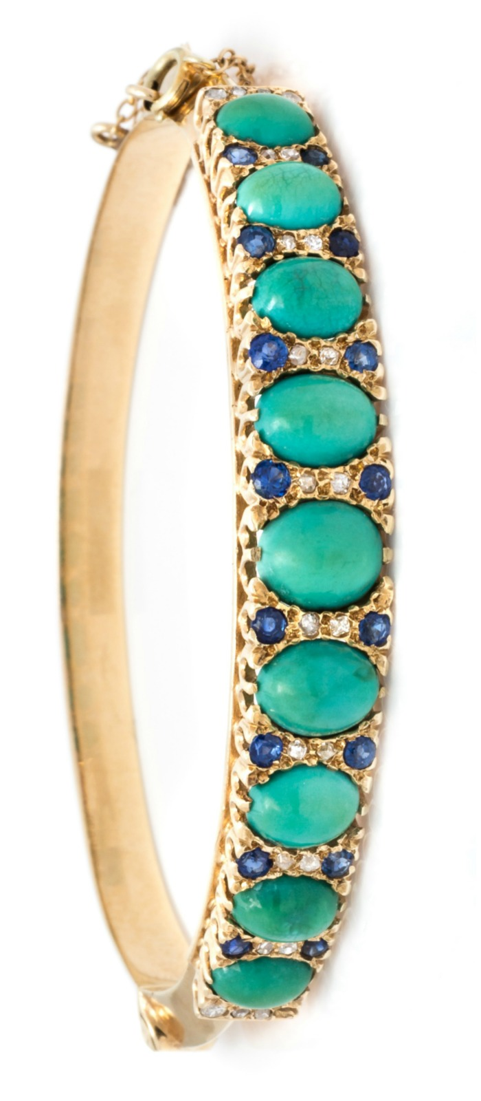 A fabulous vintage bangle bracelet with turquoise, sapphires, diamonds, and wonderful sparkling old mine cut diamonds.