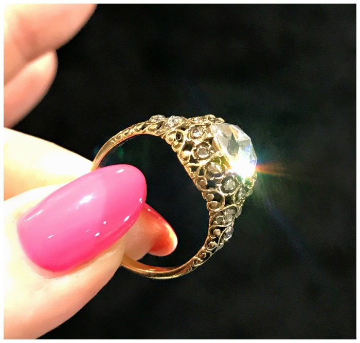 An antique gold and rose cut diamond ring from Jogani catching a shaft of sunlight at the Original Miami Antique Show.