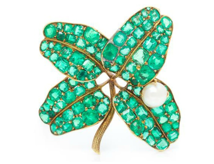 An extraordinary four leaf clover brooch by the renowned Pauling Farnham for Tiffany & Co., circa 1895. Green gold with emeralds and a pearl.