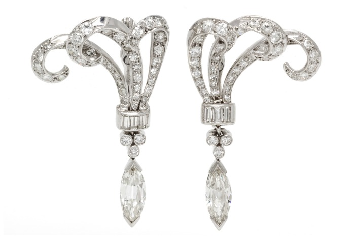 I love these platinum and diamond earrings! They're vintage, with nearly 10 carats of diamonds.