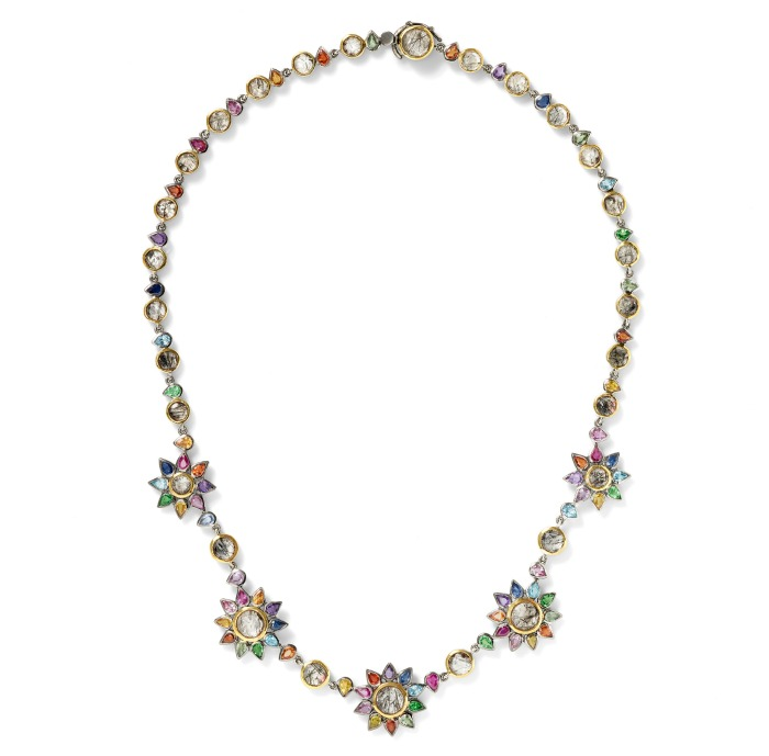 The beautiful Daisy Chain necklace by SheBee, with brightly colored sapphires and tourmillated quartz in silver and gold.