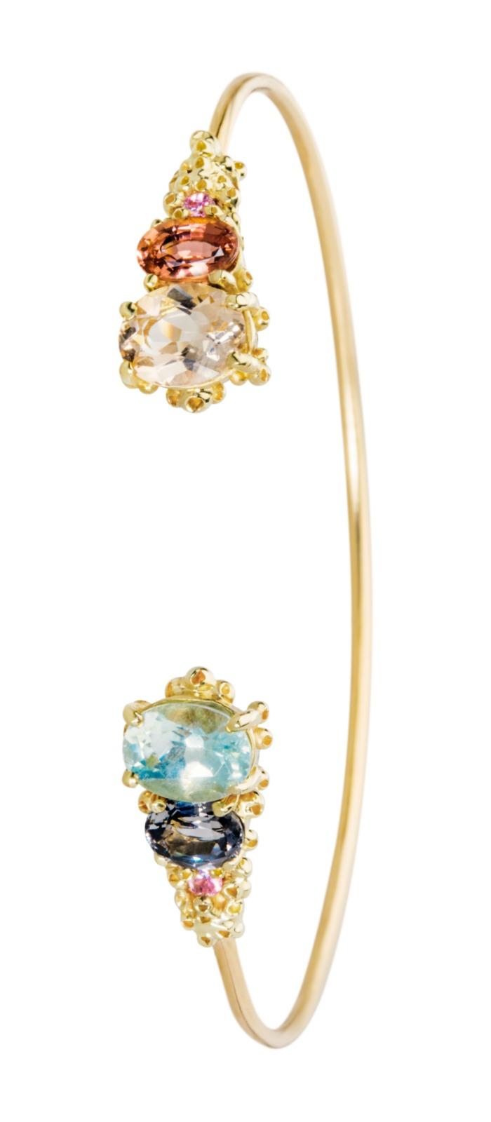A beautiful handmade cuff bracelet by Ruta Reifen, with morganite, tourmaline, aquamarine, and blue spinel gemstones.