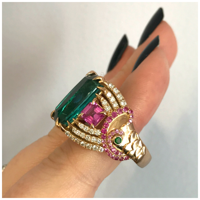 This is the incredible one of a kind mermaid ring by GiGi Ferranti! That center stone is a beautiful kind of tourmaline called indicolite.