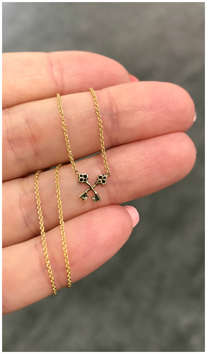 I love this itty bitty crossed key necklace from Pyrrha's new 14K gold collection.