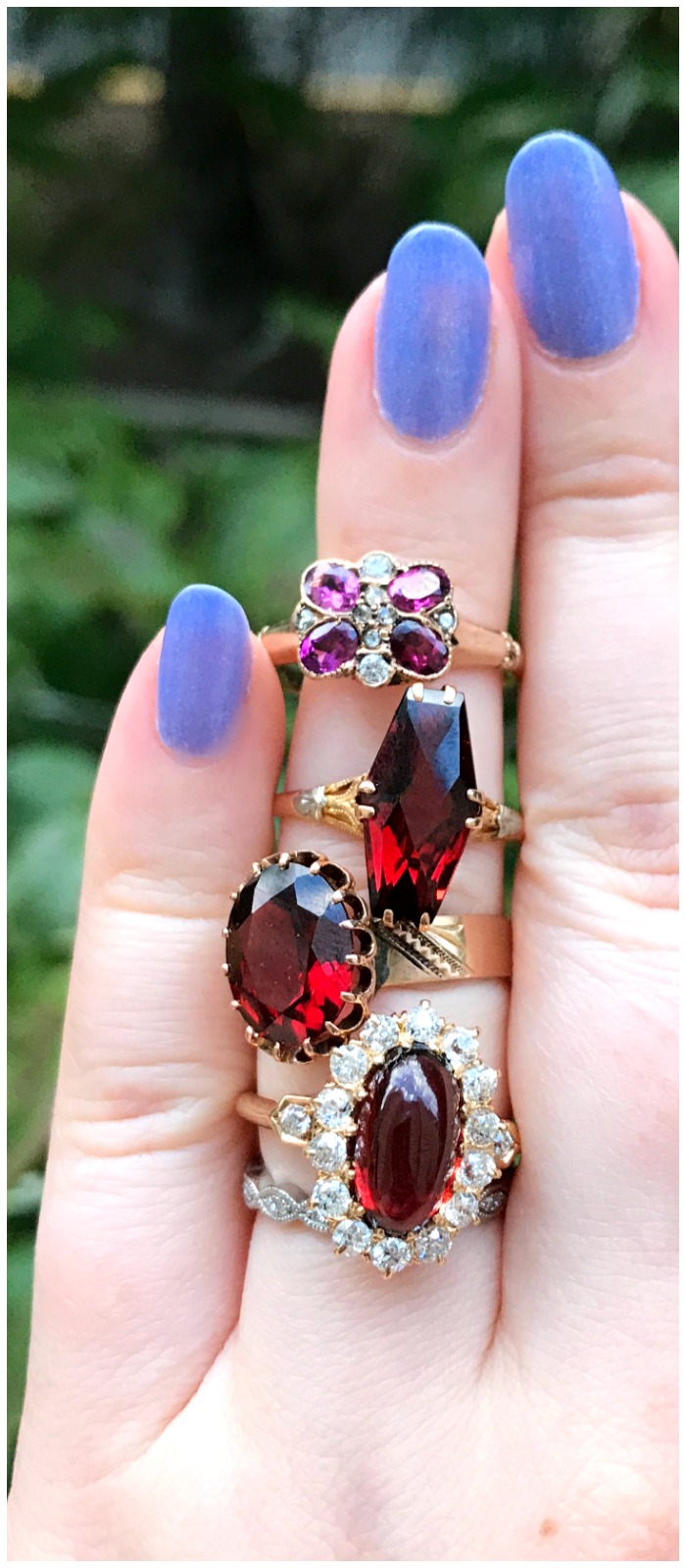 A glorious, glowing garnet one finger ring stack! All antique rings, all from Three Graces.