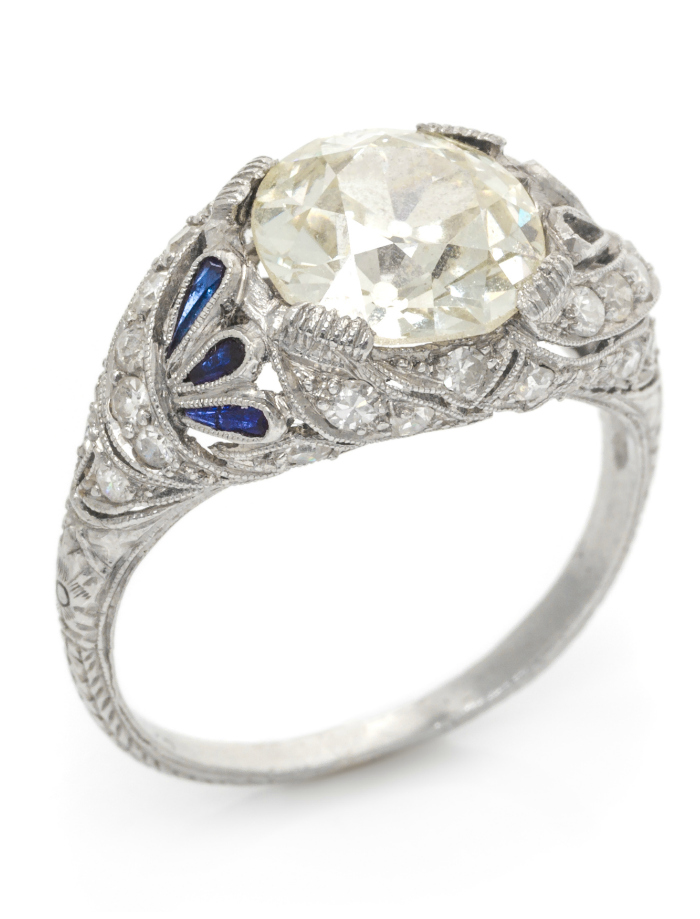 A dreamy antique engagment ring from the Edwardian era with an old European cut center stone (2.84 carats and sapphire and diamond accents.