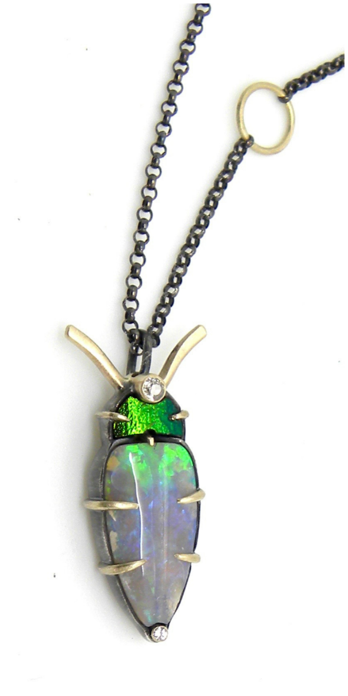 A one of a kind opal bug pendant necklace by Hannah Blount.