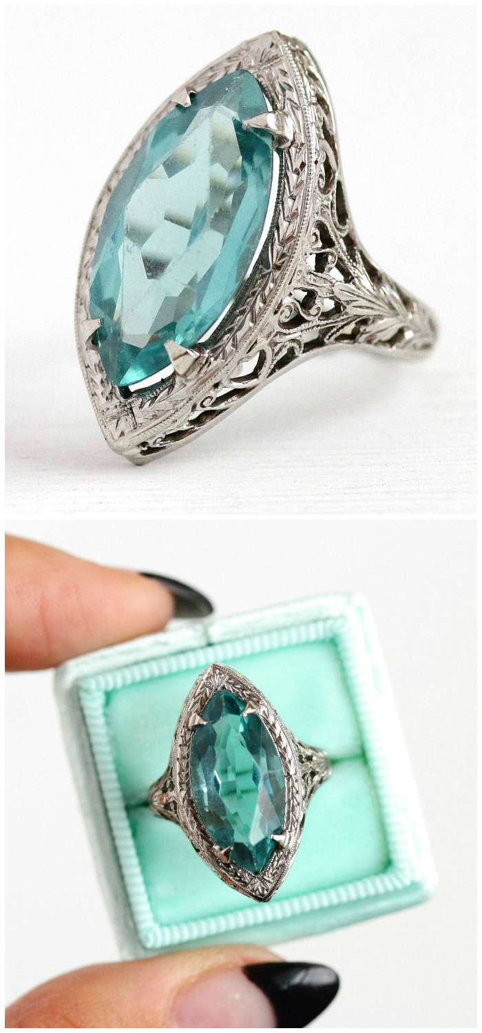 A beautiful vintage ring from the 1920's. Art Deco era, with lovely white gold filigree details.