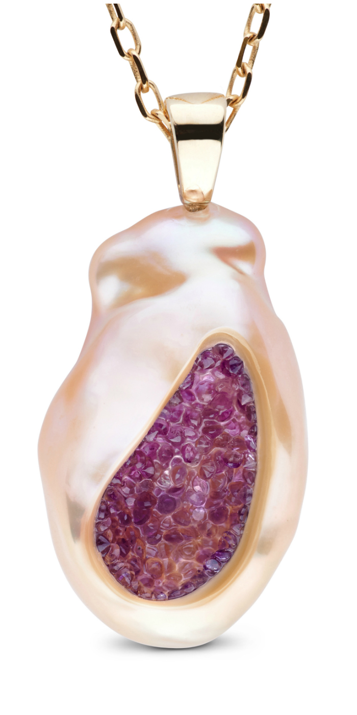 A lavender freshwater souffle pearl is carved and lined with genuine amethyst stones and set in 14K gold bale. What a wonderful pearl necklace by little h!!