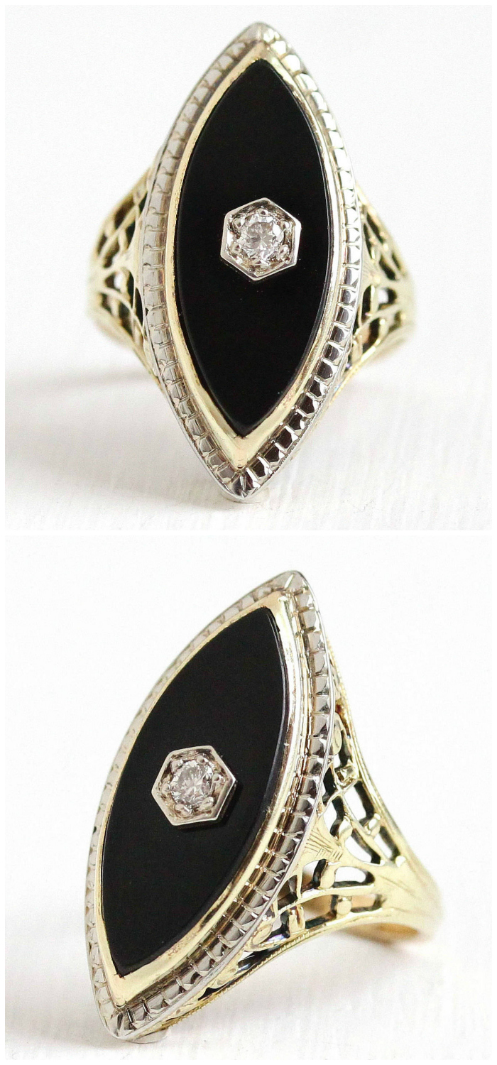 An antique Art Deco ring with onyx and beautiful filigree detailing.