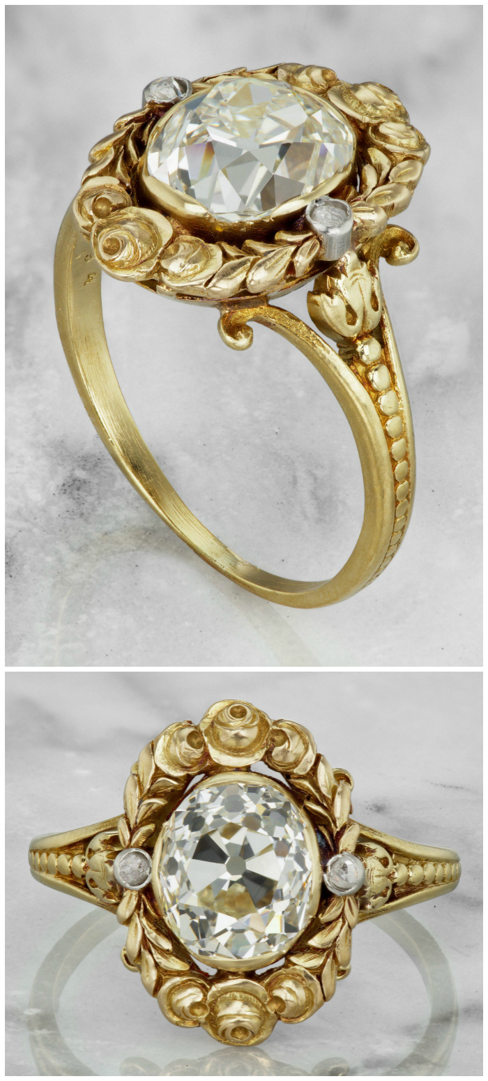 An exquisite Edwardian era engagement ring with a 2.49 carat old mine cut diamond in a beautiful floral yellow gold setting.