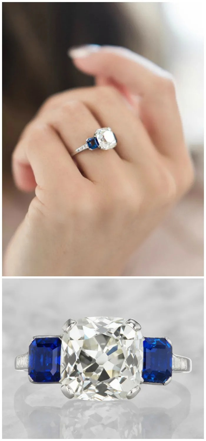 This glorious vintage Art Deco era engagement ring features a magnificent 4.21 carat old mine cut diamond between two no-heat blue sapphires.