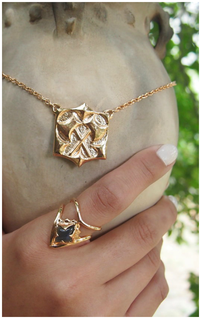 A selection of beautiful gold jewelry from Kristen Dorsey's Hatchet Women collection.