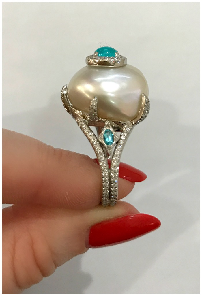 A stunning pearl and Paraiba tourmaline ring by Erica Courtney.