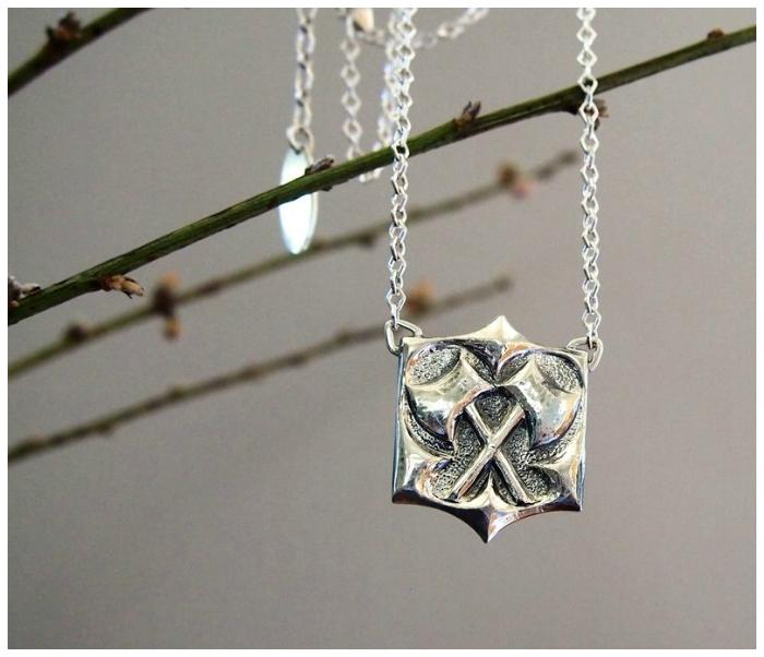 Kristen Dorsey's Hatchet pendant in sterling silver.