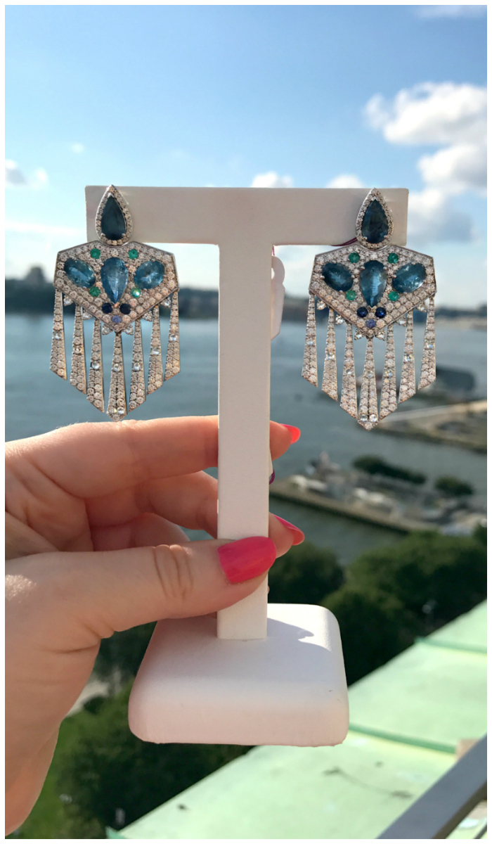 The Macaw earrings by Graziela, with diamonds, aquamarine, Paraiba and sapphires.