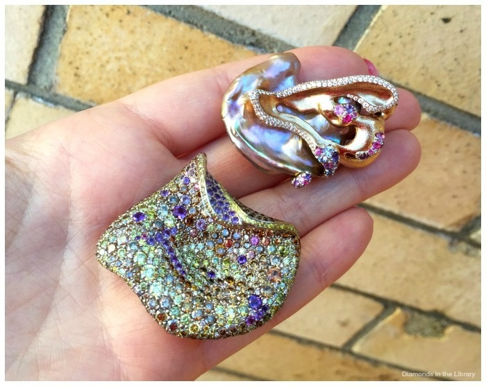 Two brooches by the fabulous Naomi Sarna Designs; colored sapphires, amethysts, and diamonds and a freshwater baroque cultured pearl.